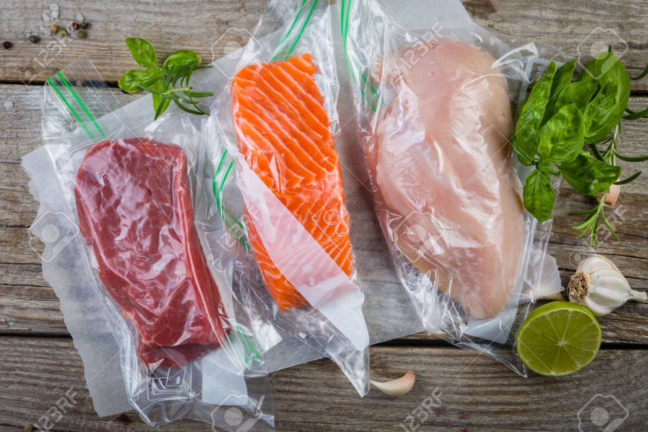 Beef, chicken and salmon in vacuum plastic bag for sous vide cooking Stock Photo - 74051043