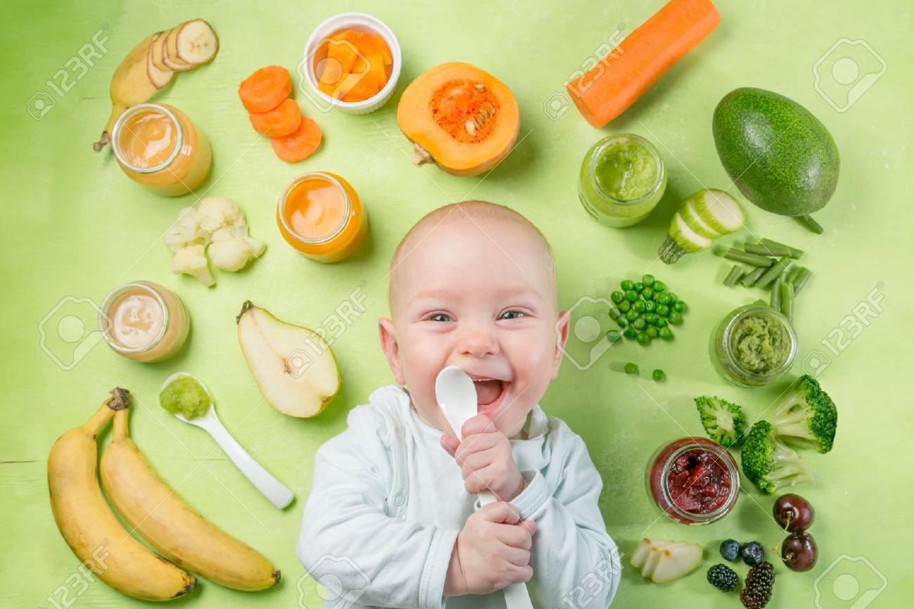 Colorful baby food purees in glass jars - 90945109
