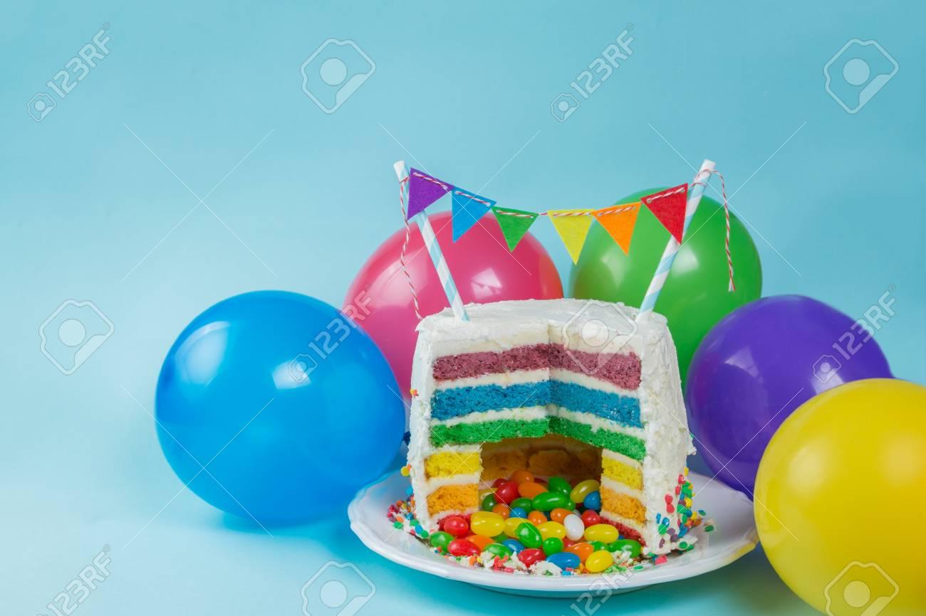 Stupendous Rainbow Pinata Cake With Candies Birthday Background Card Funny Birthday Cards Online Benoljebrpdamsfinfo