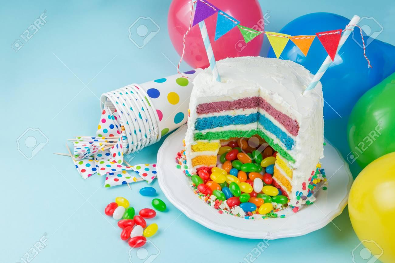 Pleasing Rainbow Pinata Cake With Candies Birthday Background Card Funny Birthday Cards Online Benoljebrpdamsfinfo