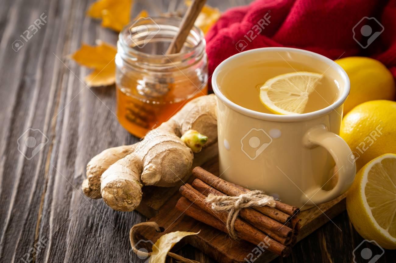 Autumn hot drink - ginger, lemon, honey tea and ingredients - 110276902