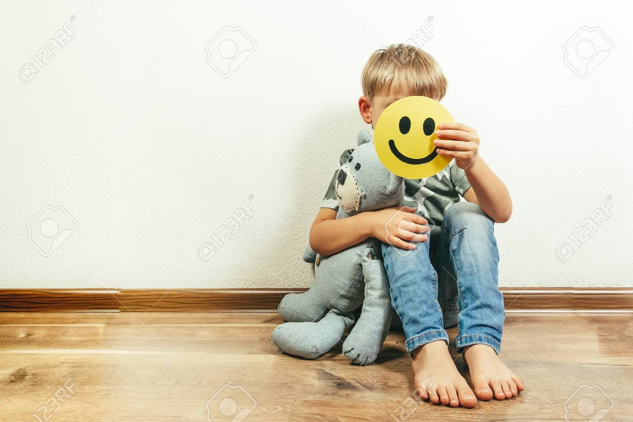 Depressed boy holding smile, pretending to be fine. Face of the depression - 114105596