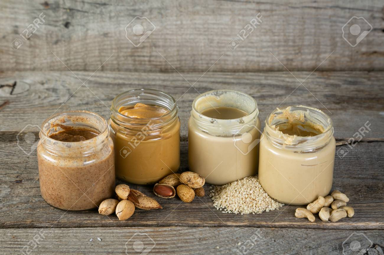 Selection of nut butters - peanut, cashew, almond and sesame seeds - 116033445