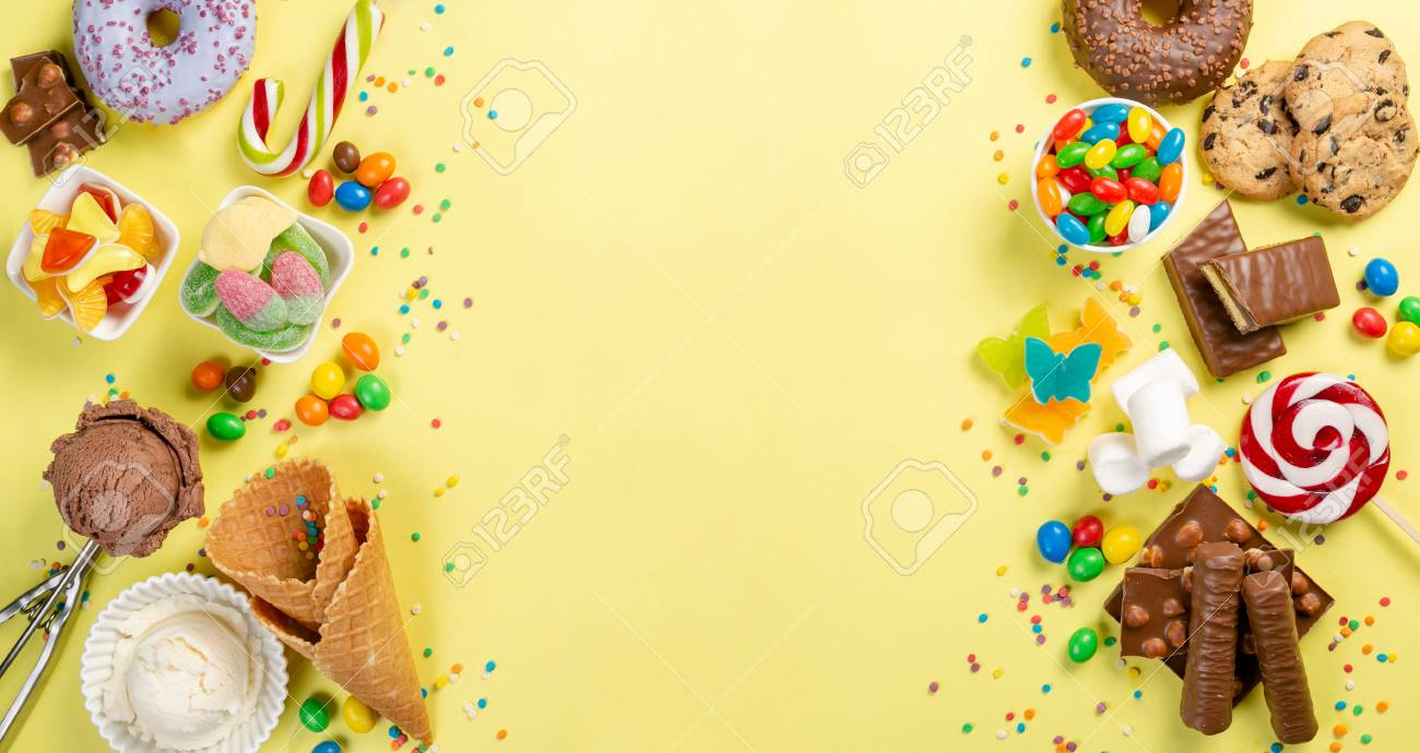 Selection of colorful sweets - chocolate, donuts, cookies, lollipops, ice cream - 117761897