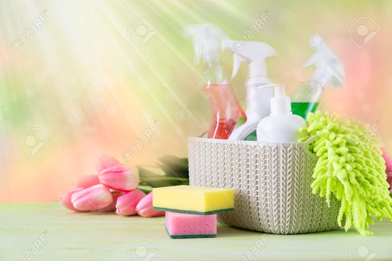 Spring cleaning concept - cleaning supplies and flowers on blur background - 162760897