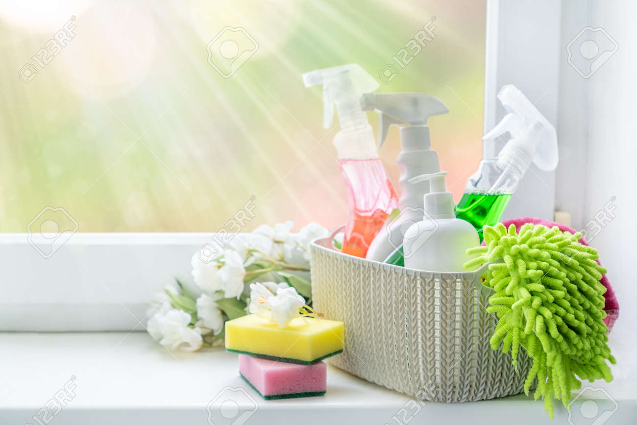 Spring cleaning concept - cleaning supplies and flowers on blur background - 162760900