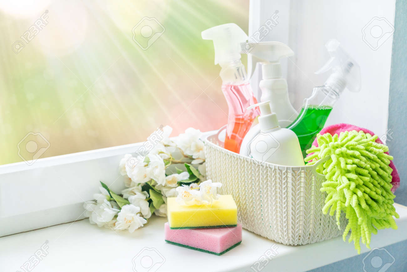 Spring cleaning concept - cleaning supplies and flowers on blur background - 162760901