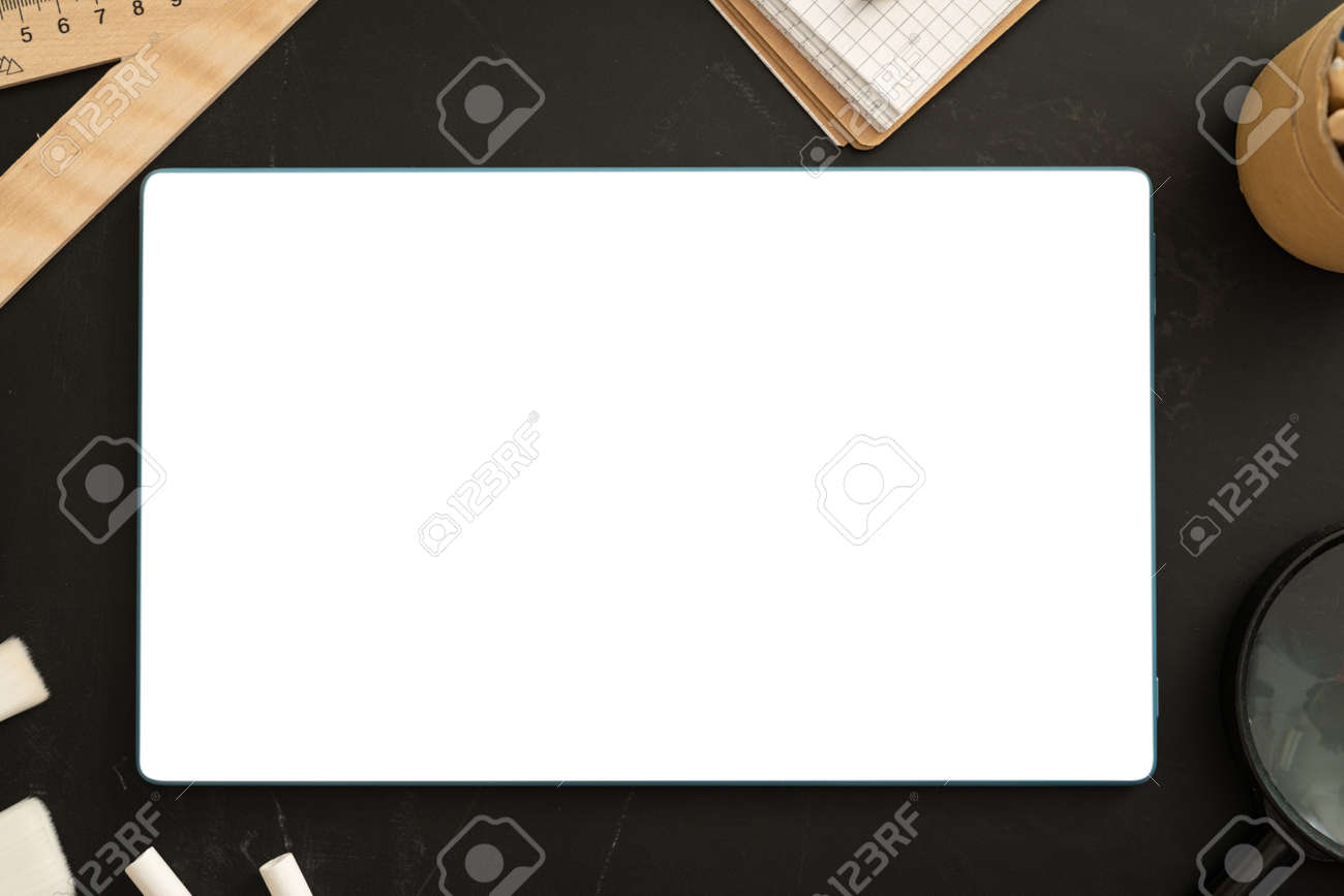 Online school class cover - celection of stationery on black board - 164101160