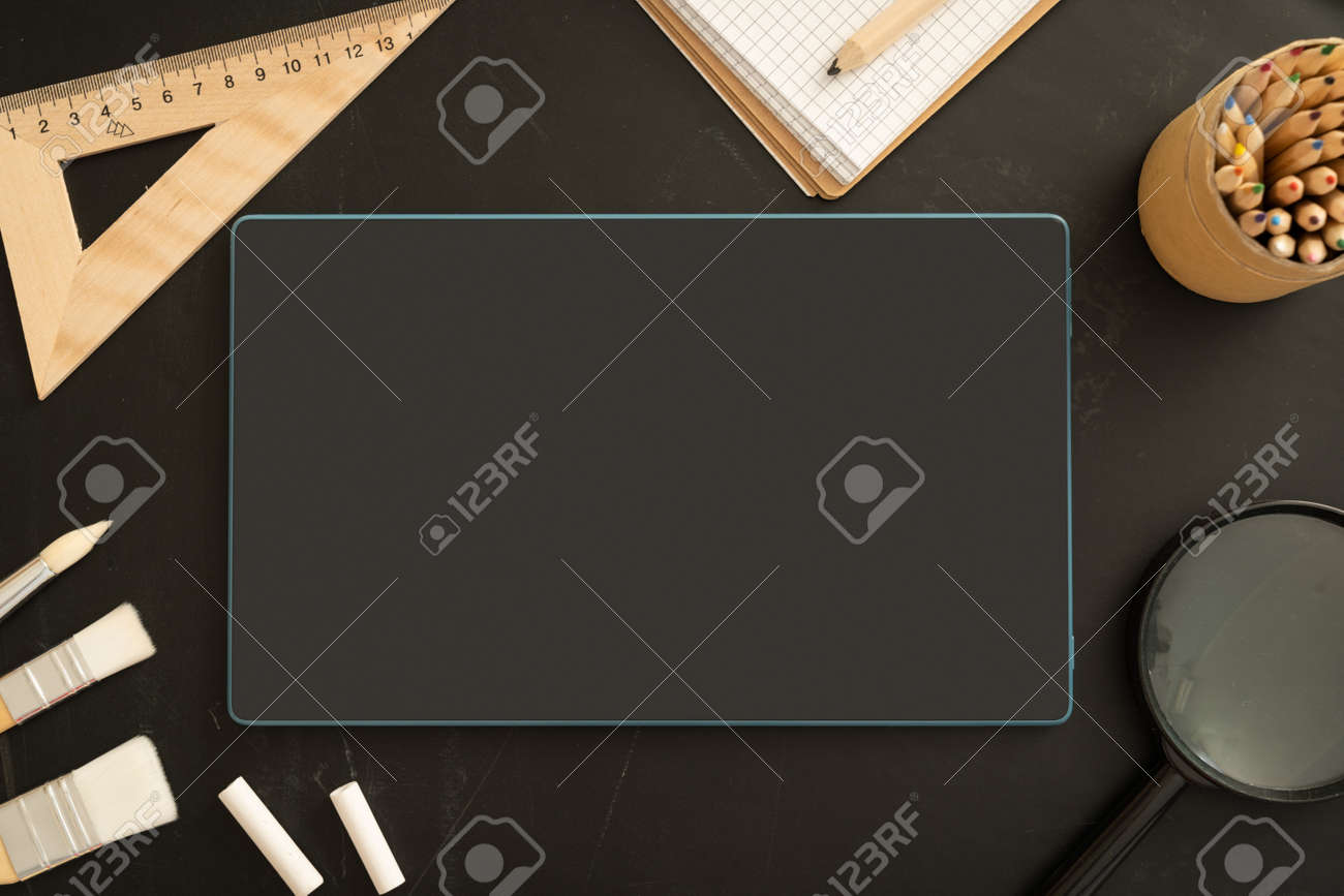 Online school class cover - celection of stationery on black board - 164101173