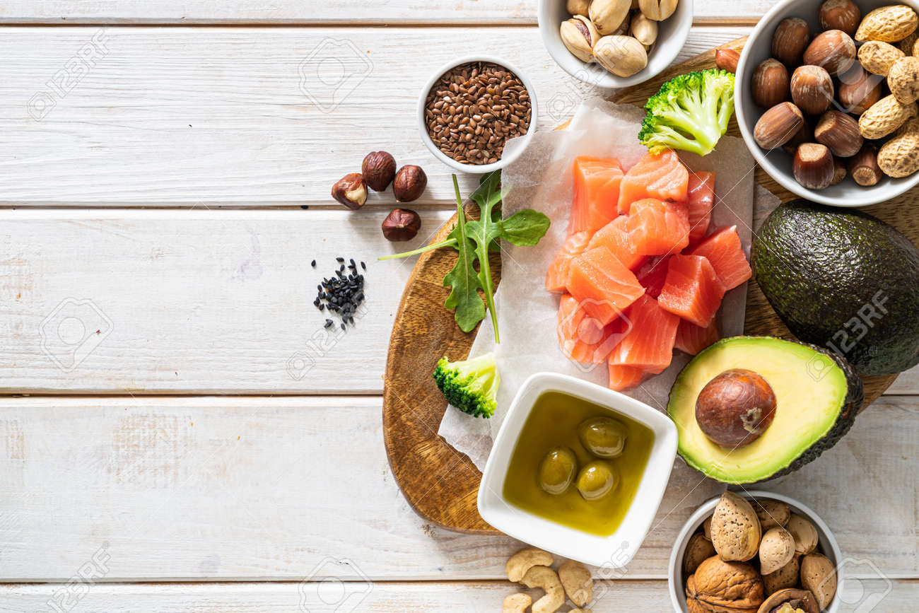 Keto diet concept - good fat sources on white wood table - 170905369