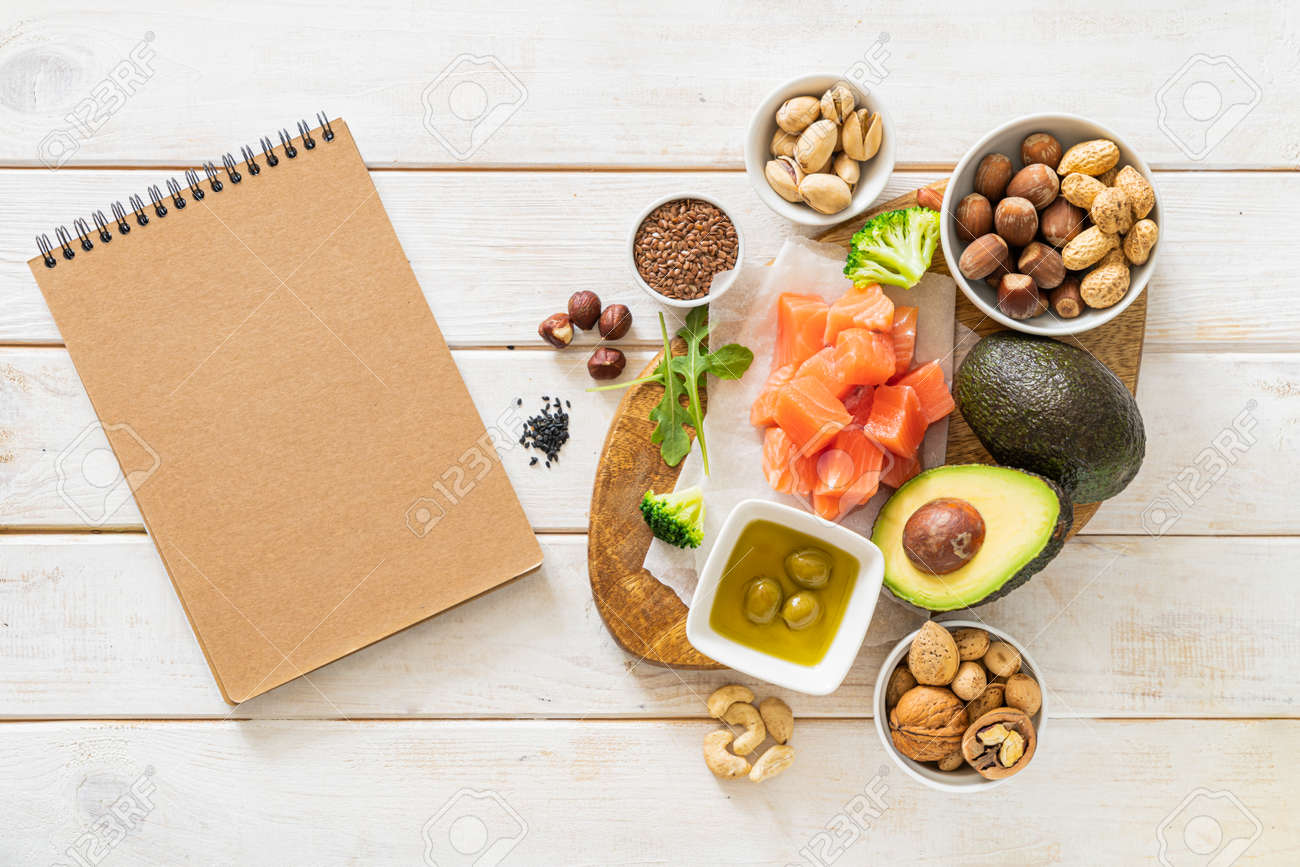 Keto diet concept - good fat sources on white wood table - 170905373