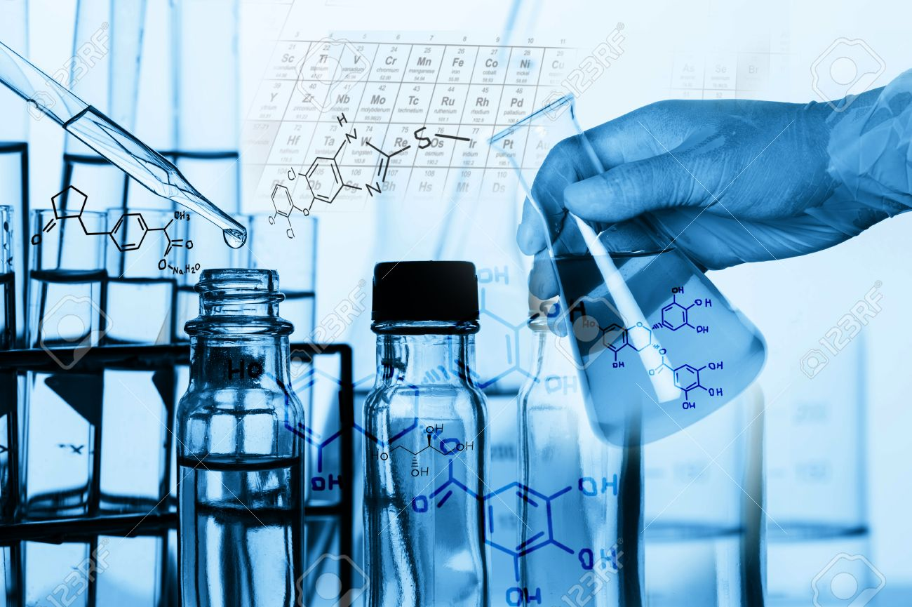 Researcher is dropping the reagent into test tube, with chemical equations background, in laboratory - 50001062