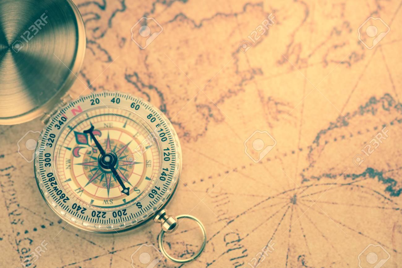 mapa vintage Old Gold Vintage Compass On Vintage Map:Heading South Stock Photo  mapa vintage