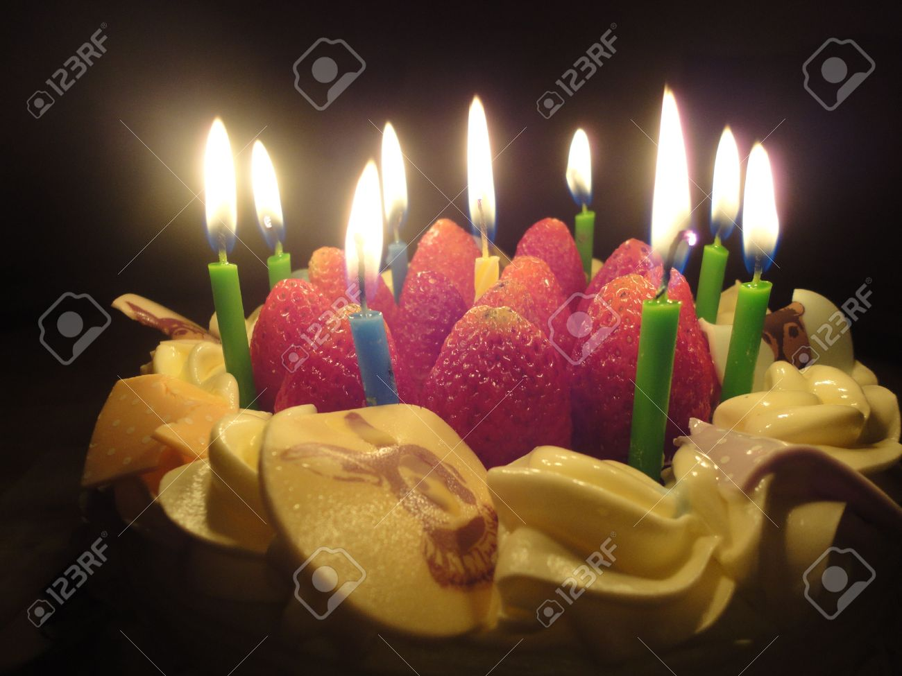 birthday cake with sweet strawberry and light candle in the dark & Birthday Cake With Sweet Strawberry And Light Candle In The Dark ...