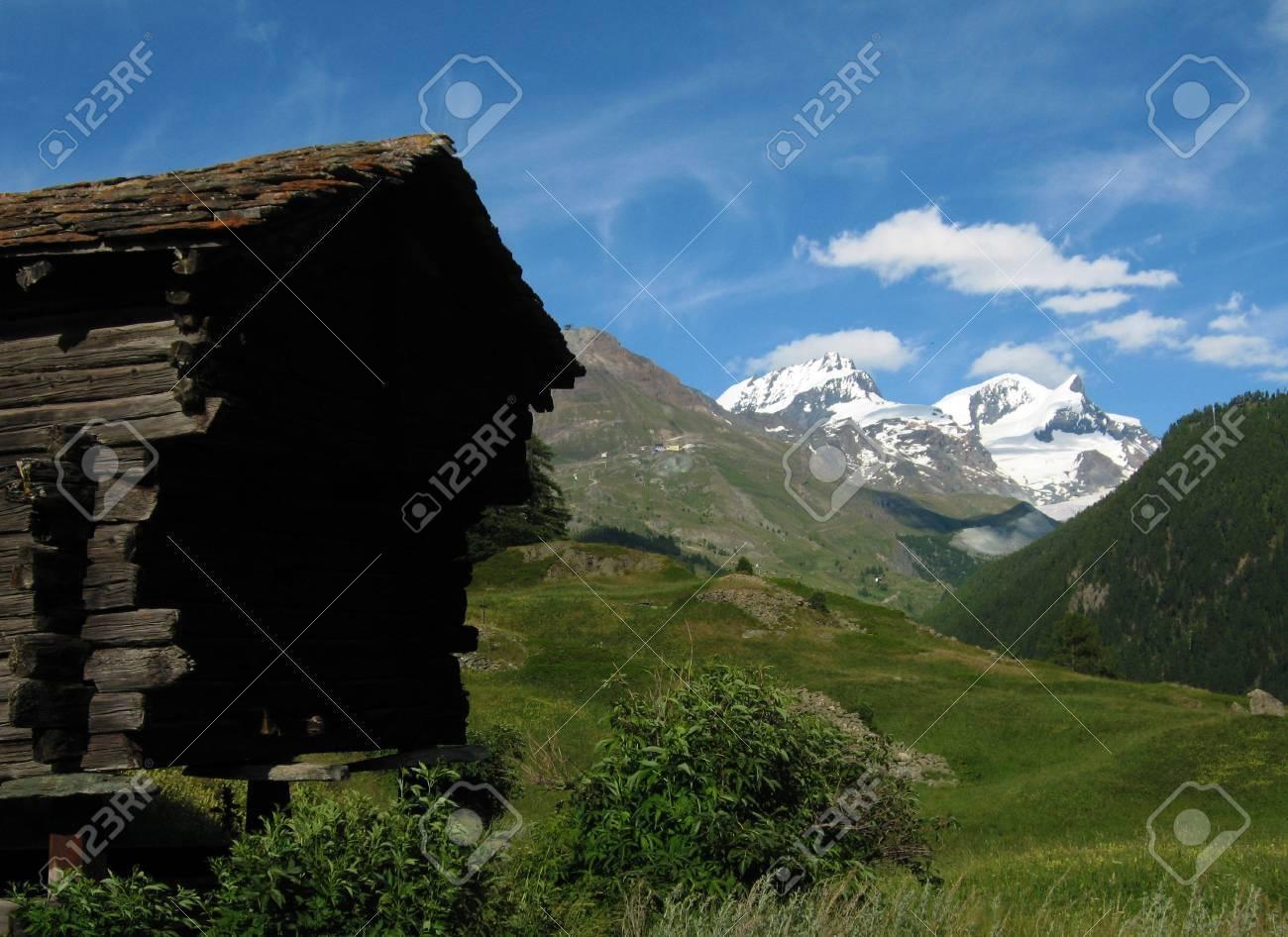 Wooden Hut and Alps Meadows, Zermatt, Switzerland Stock Photo - 14396071