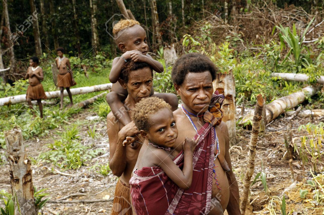 Women and Children of the Nomadic Forest Tribe Korowai  West
