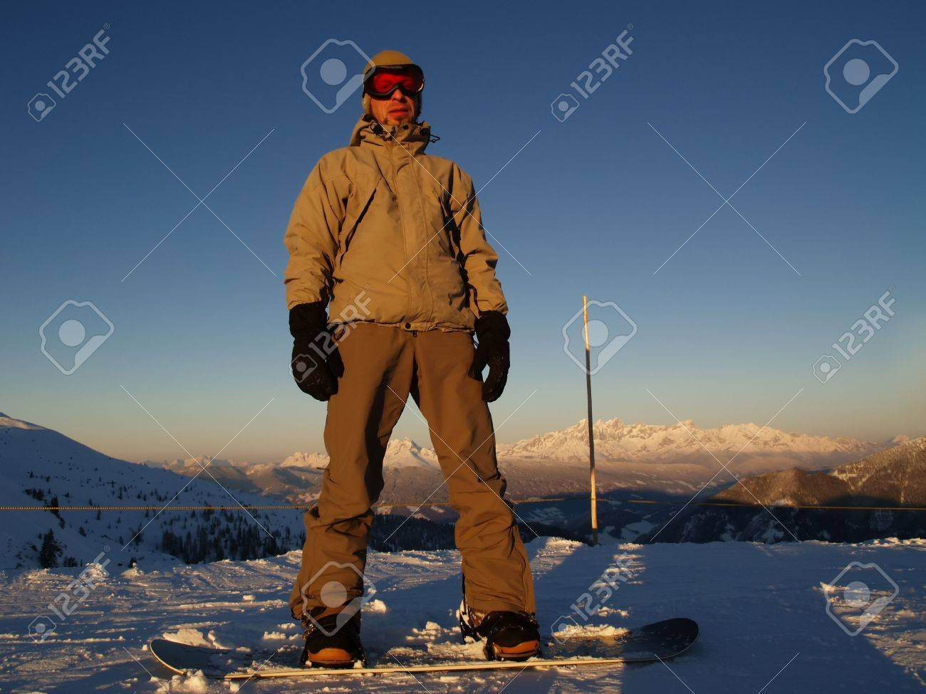 A snowboarder standing on the top of the hill. Stock Photo - 2715369