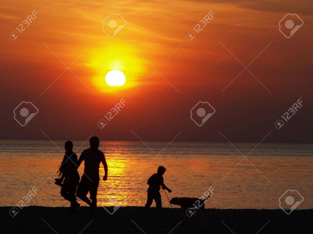 Family at the beach at sunset Stock Photo - 3093652
