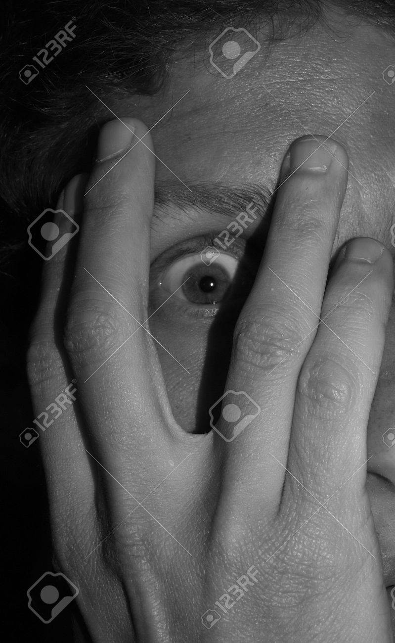 A scared man covering his face with his hand Stock Photo - 3170726
