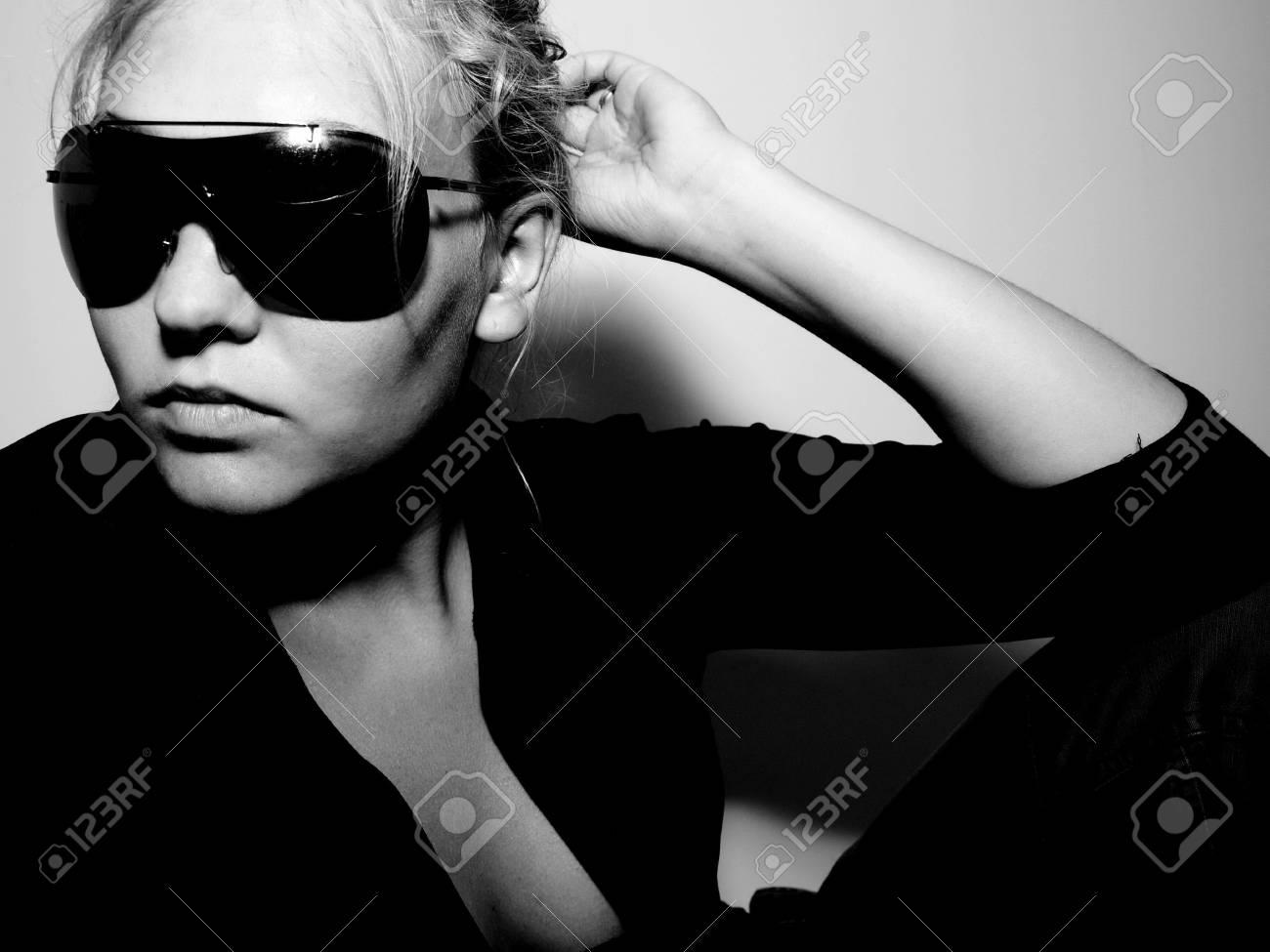 Girl in sunglasses posing Stock Photo - 3364371