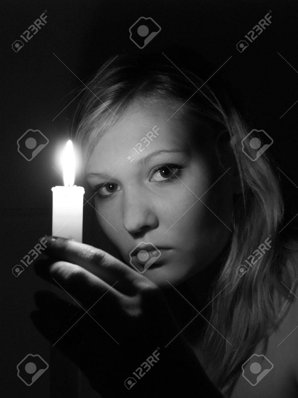 Girl with candle Stock Photo - 3626830