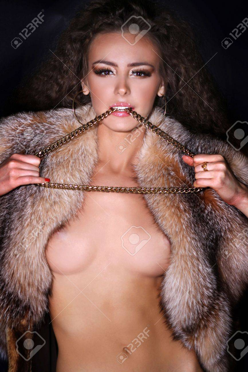 Sexual model in a fur coat Stock Photo - 6106414