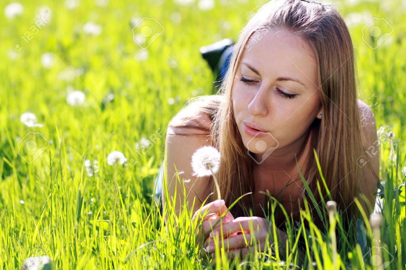 Dandelion - The girl blows on a dandelion Stock Photo - 8467249