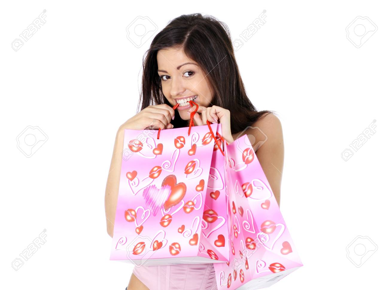 Shopping woman smiling. Isolated over white background Stock Photo - 11359856