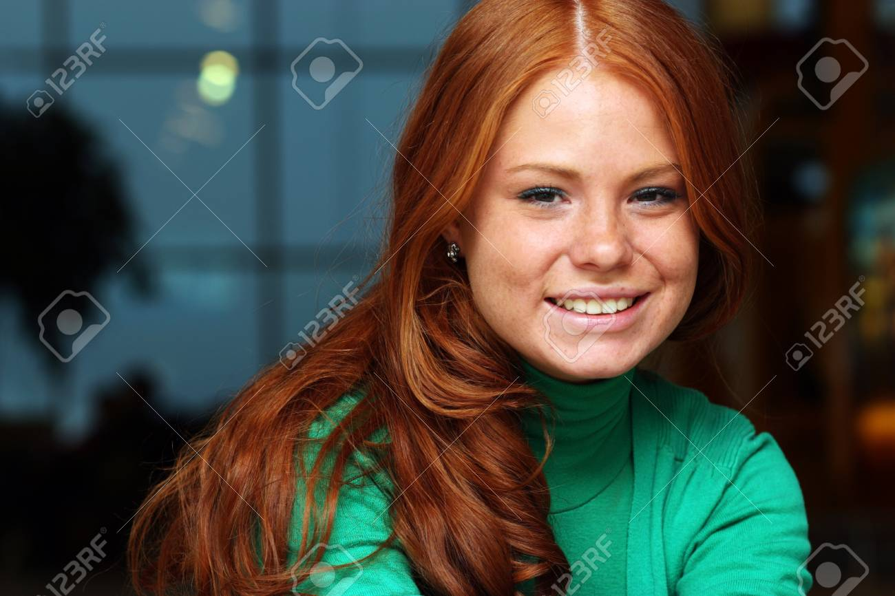 Young beautiful redhair woman Stock Photo - 17483448