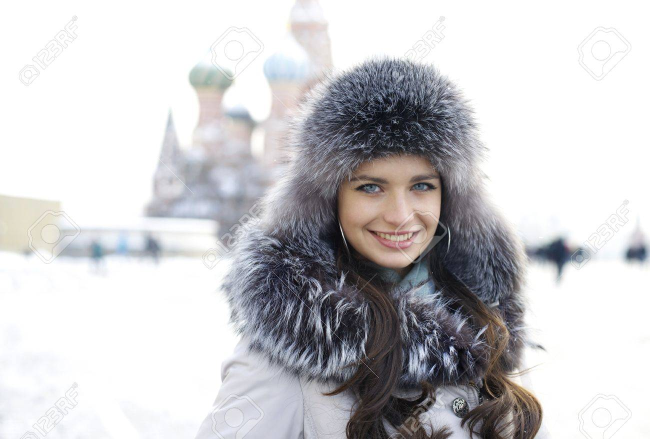 Portrait of a young woman on the background of a winter city Stock Photo - 17507710
