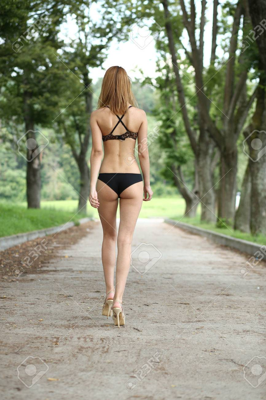 Beautiful young woman walking on the summer park Stock Photo - 23413027