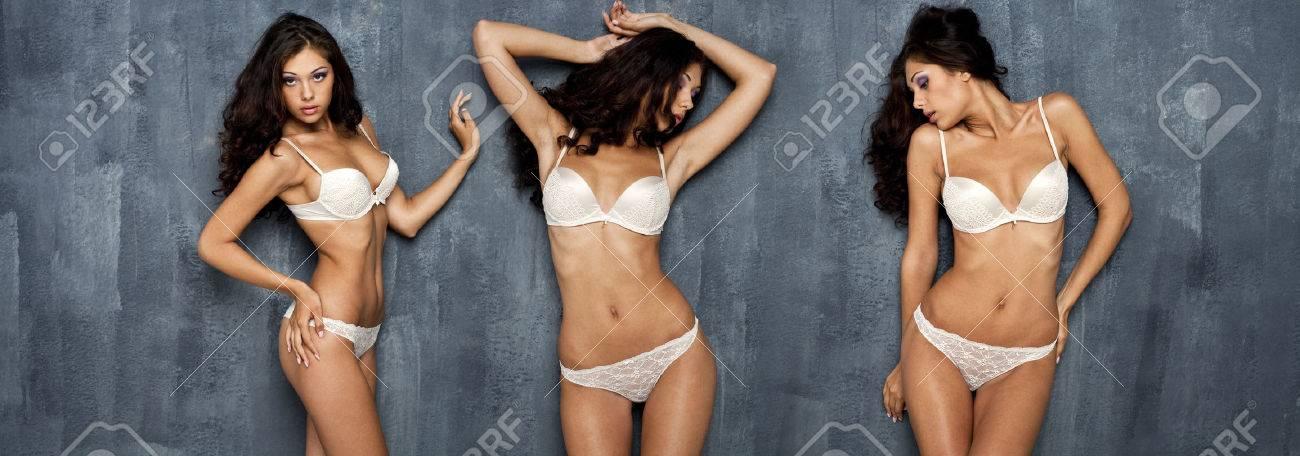 Portrait of sexy women in white underwear on a dark wall Stock Photo - 24132588