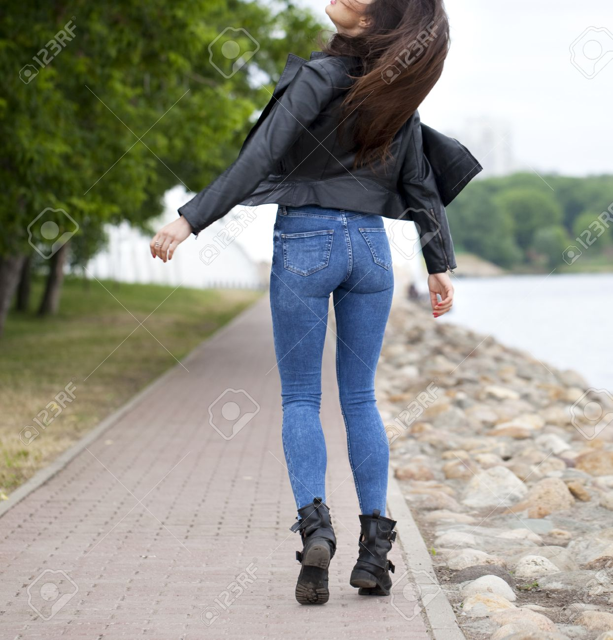 Beautiful Female Ass In Blue Jeans Back Away Stock Photo, Picture ...