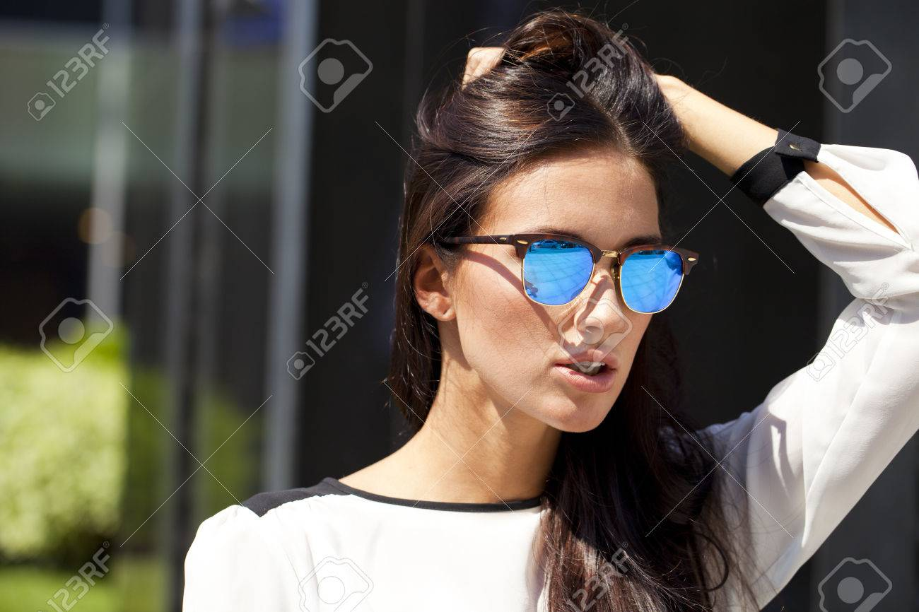 Stock Photo - Young beautiful business woman with blue mirrored sunglasses 68417e20fed
