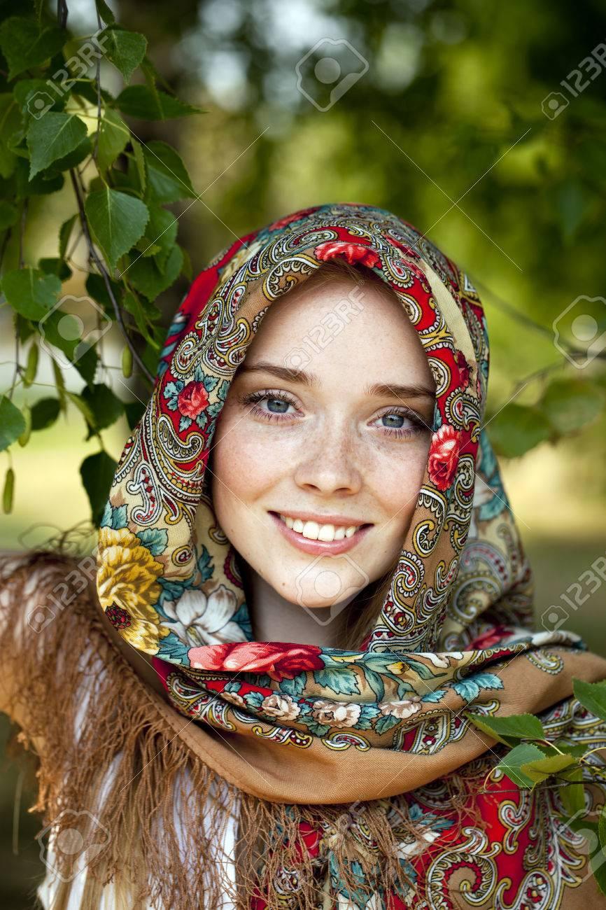 https://previews.123rf.com/images/andersonrise/andersonrise1408/andersonrise140800360/30623997-russian-beauty-woman-in-the-national-patterned-scarf.jpg