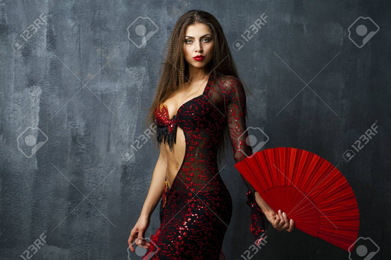 woman traditional spanish flamenco dancer dancing in a red