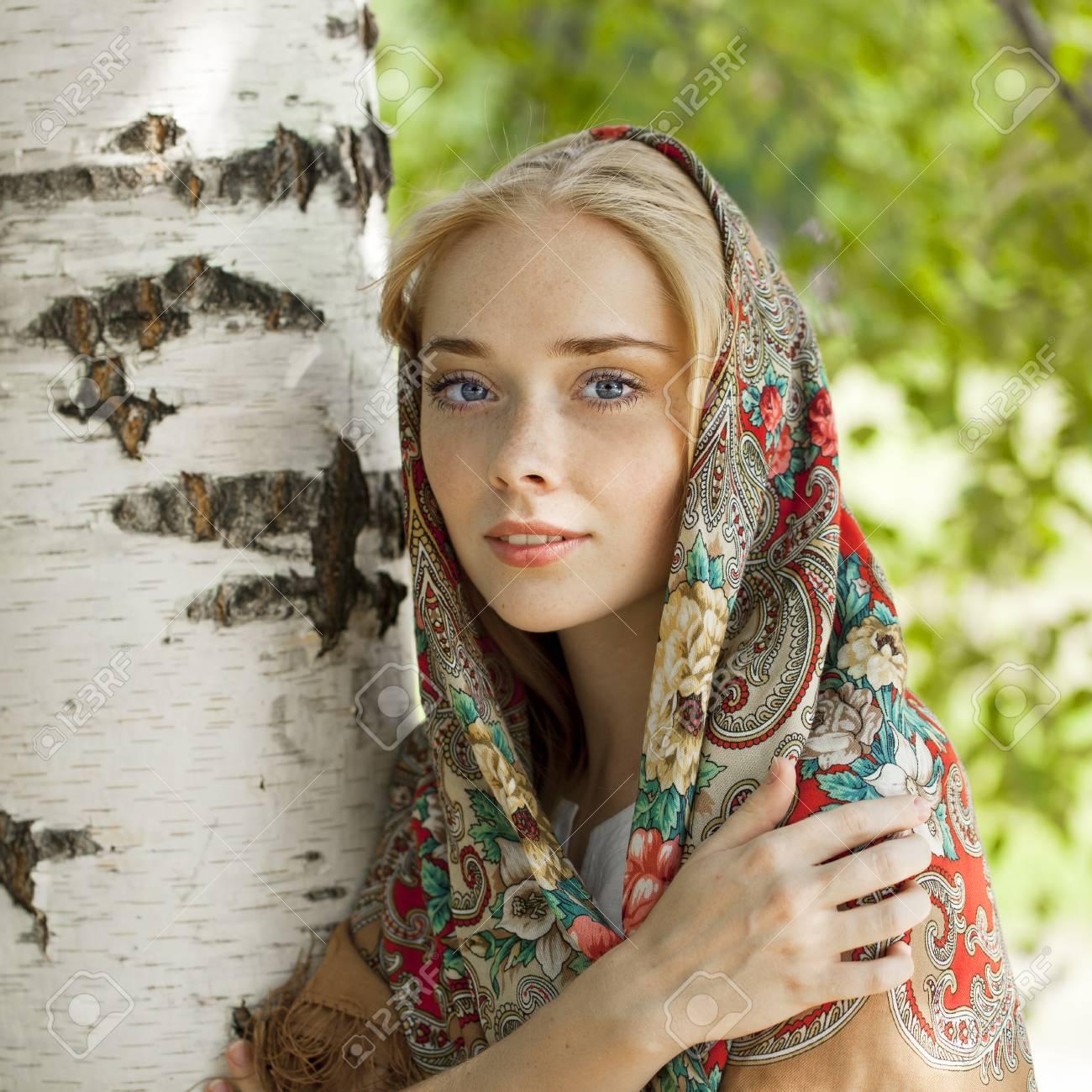 https://previews.123rf.com/images/andersonrise/andersonrise1503/andersonrise150301224/37574369-russian-beauty-woman-in-the-national-patterned-scarf.jpg