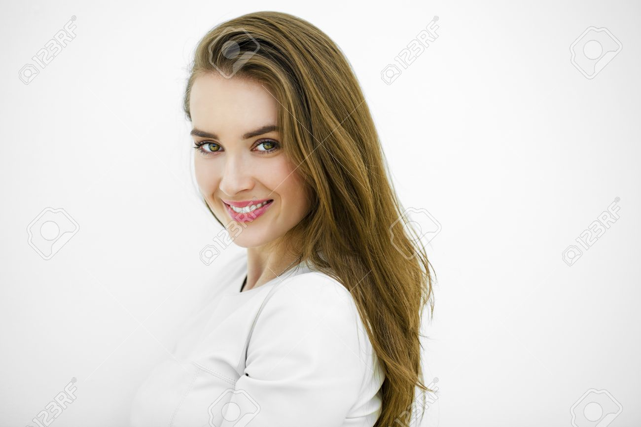 Beautiful young sexy woman posing against a white wall Stock Photo - 39653243
