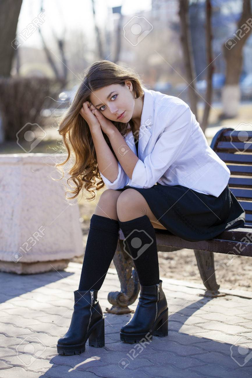 Stock Photo Young Beautiful Blonde Schoolgirl Sitting On A Bench Spring Street