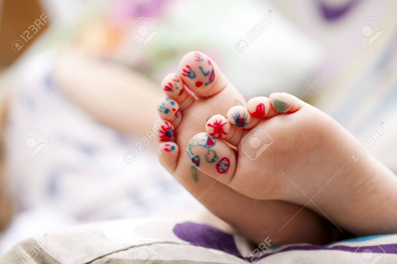 Body part, Painted childrens fingers feet Stock Photo - 41679933