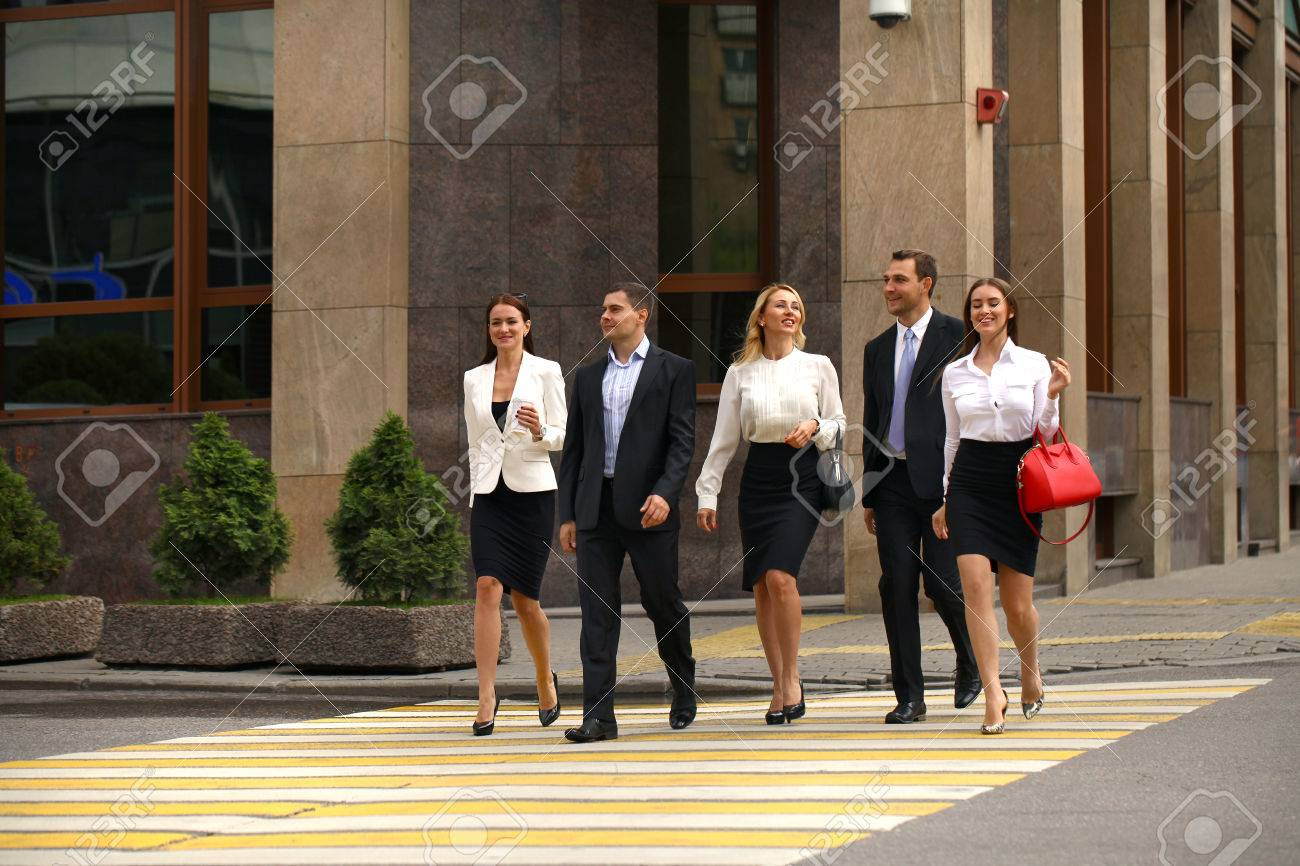 Full length portrait of a young Five successful business people crossing the street in the city center Stock Photo - 42429944
