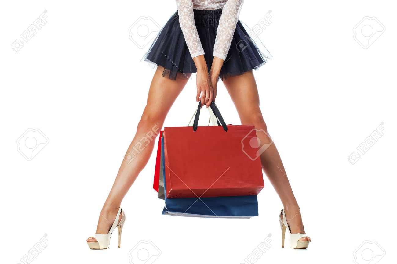 Part body, beautiful female slender legs. Sexy girl holding a paper shopping bags, isolated on white background Stock Photo - 44905517