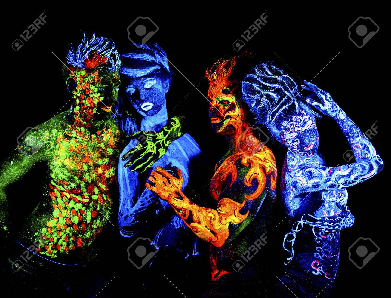 Four elements. Body art glowing in ultraviolet light, isolated on black background - 56072866