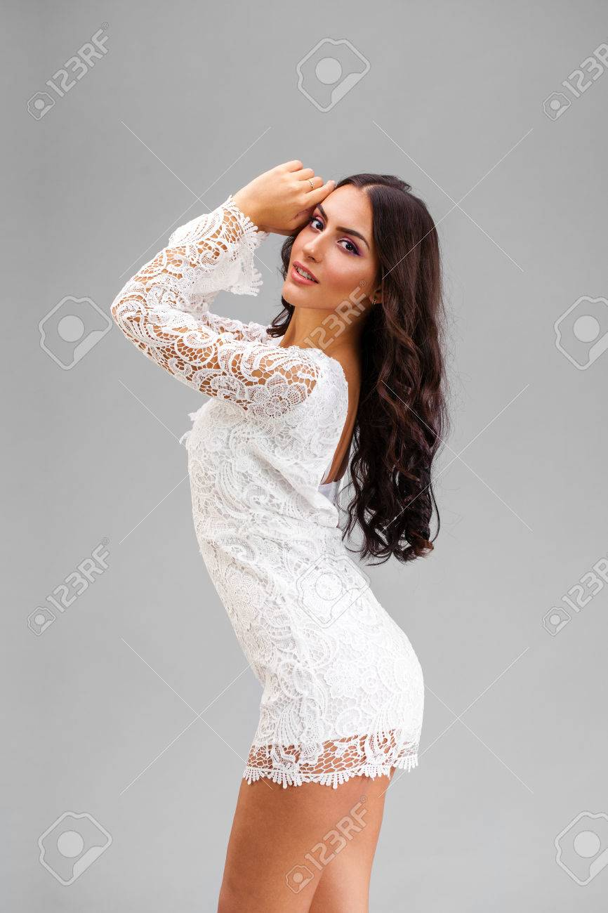 Young Arabic Woman In White Sexy Dress Isolated On Gray Background