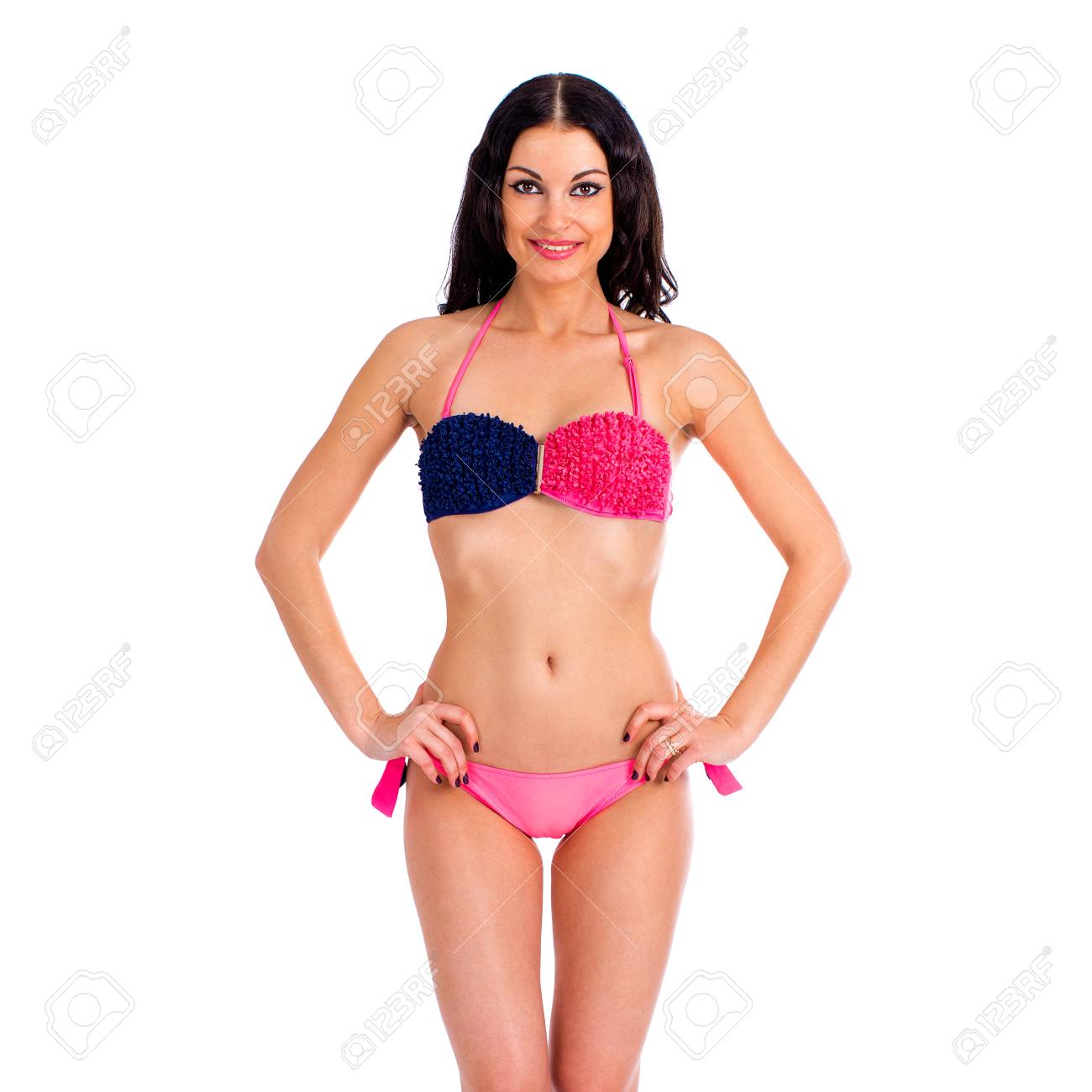 e5319177cec Beautiful young brunette woman in pink and blue bikini standing isolated on white  background Stock Photo
