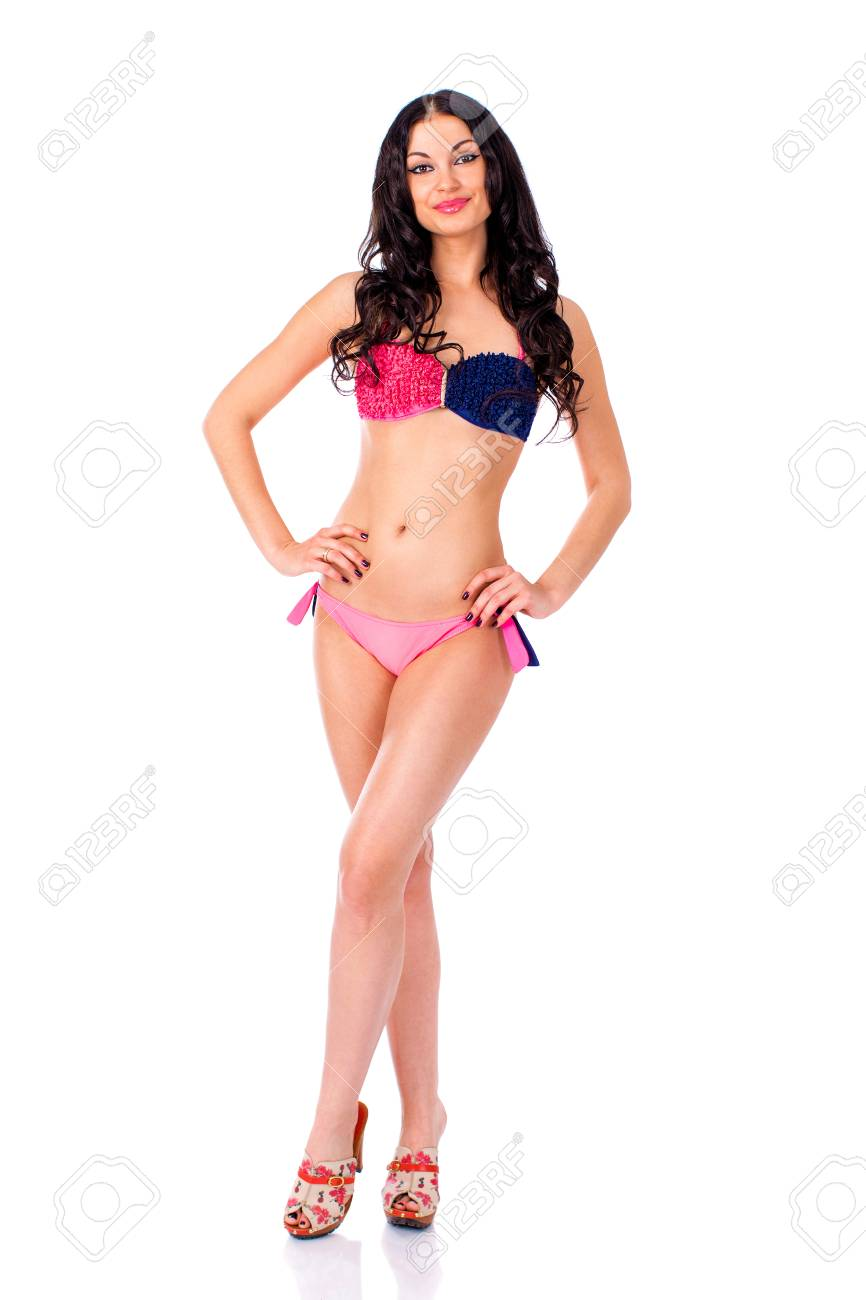 a26d7193eb6 Beautiful young brunette woman in pink and blue bikini standing in full  growth and isolated on