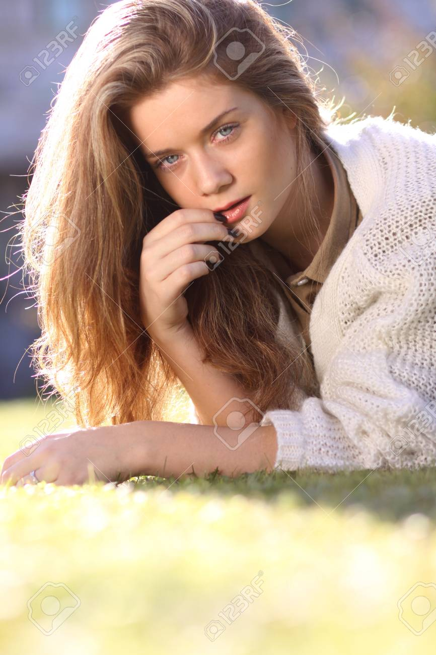 Attractive Sweet Blonde Girl Posing Lying On The Lawn In Autumn Park Stock Photo 77188210