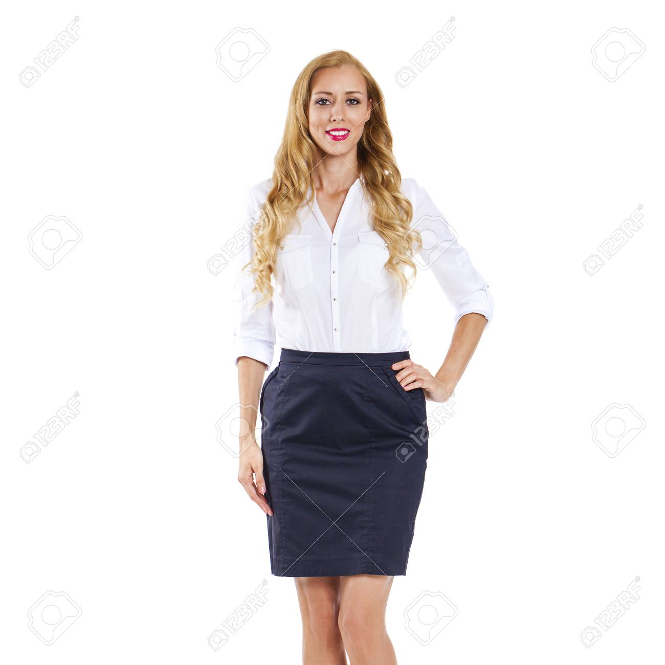 7fbc1acc97 Stock Photo - Young happy blonde woman in black skirt and white blouse,  isolated on white background