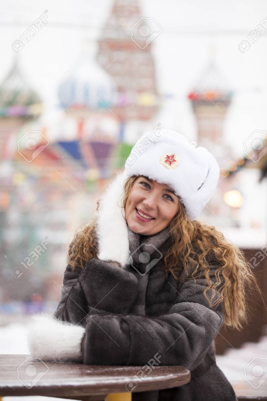3df185f94f4d3 Russian beauty. Portrait of a young beautiful girl in a white hat with a fur