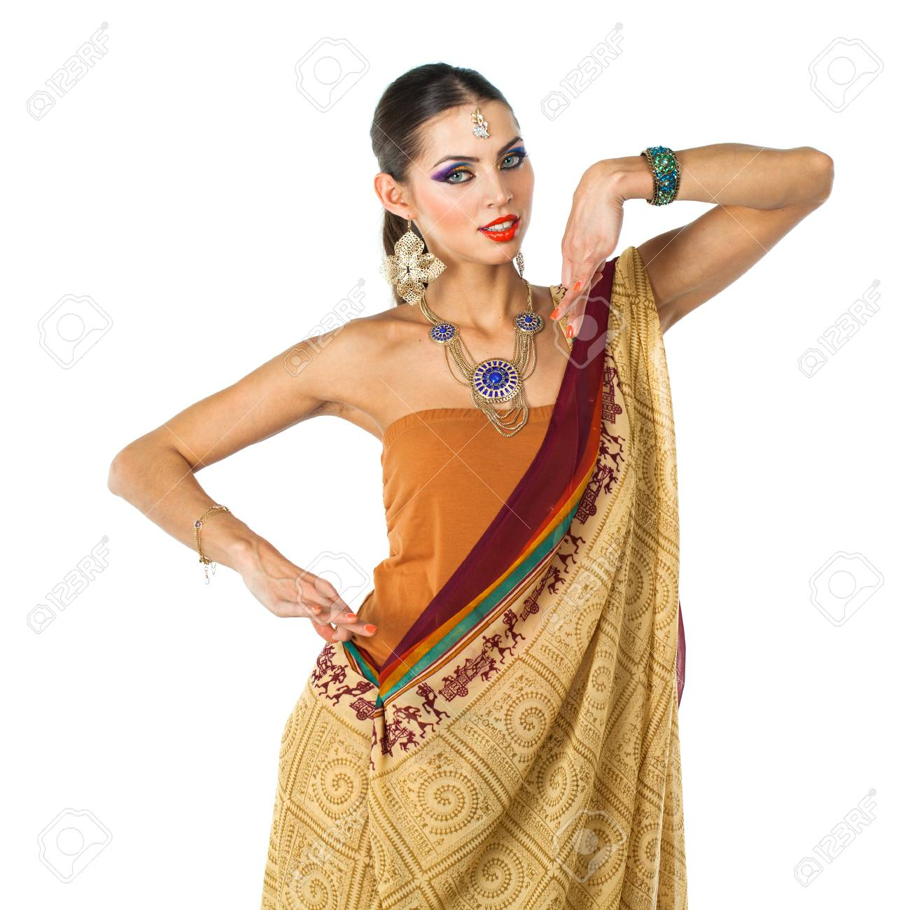 7820d29c7a Caucasian brunette woman in brown indian national dress sari in studio on white  isolated background Stock